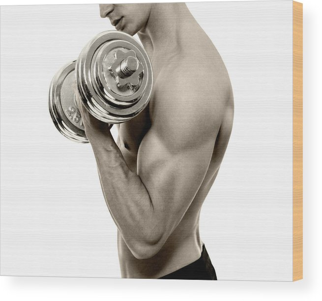 Young Men Wood Print featuring the photograph Body Builder Exercising by Gilaxia
