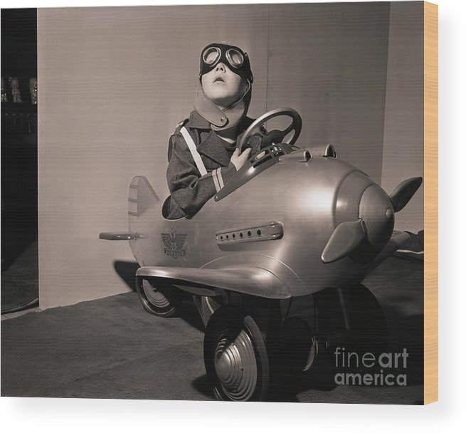 Child Wood Print featuring the photograph Boy In Aviator Suit Sitting In Toy Plane by Bettmann