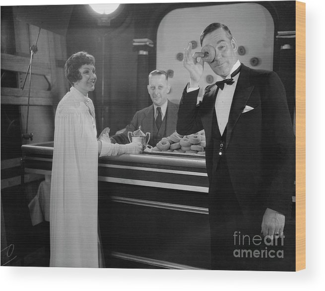 People Wood Print featuring the photograph Claudette Colbert And Walter Huston by Bettmann