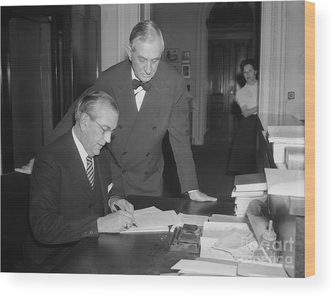 People Wood Print featuring the photograph Edwin A. Halsey Signing War On Japan by Bettmann