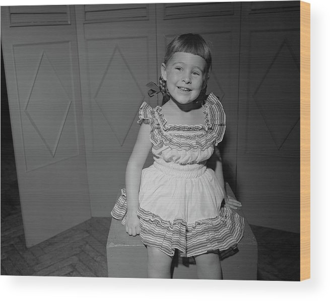Three Quarter Length Wood Print featuring the photograph Girl 6-7 Sitting On Box, Smiling by George Marks