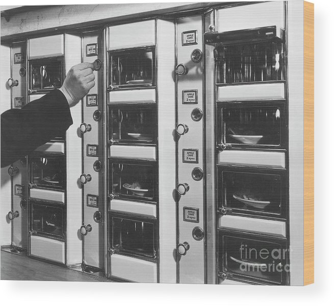 Coin Wood Print featuring the photograph Hand Placing Coin Into Automat Lunch by Bettmann