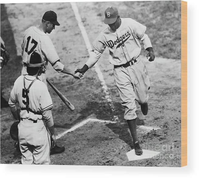 First Baseman Wood Print featuring the photograph Jackie Robinson At Home Plate, 1947 by Bettmann