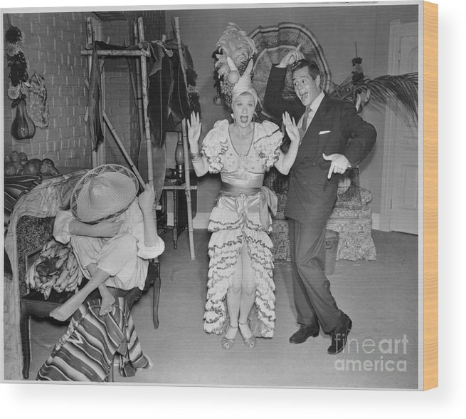 Heterosexual Couple Wood Print featuring the photograph Lucille Ball And Desi Arnaz In I Love by Cbs Photo Archive