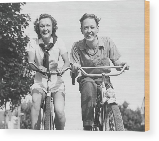 Young Men Wood Print featuring the photograph Man And Woman Riding Bikes, B&w, Low by George Marks