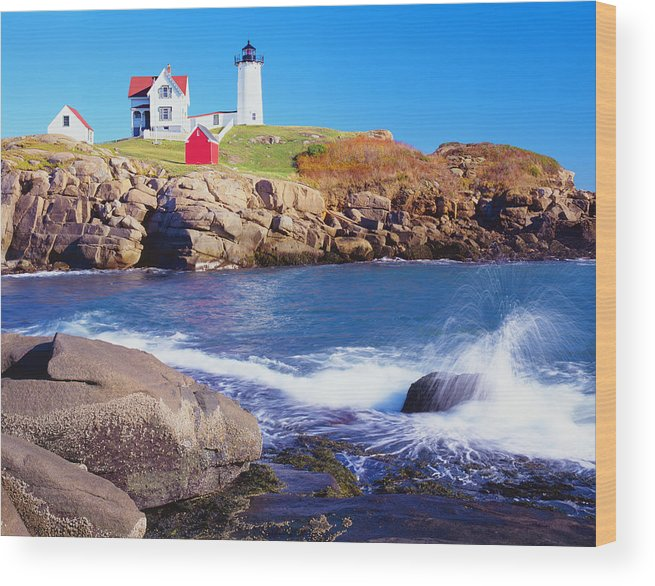 Water's Edge Wood Print featuring the photograph Nubble Lighthouse And Coastine Of Maine by Ron thomas
