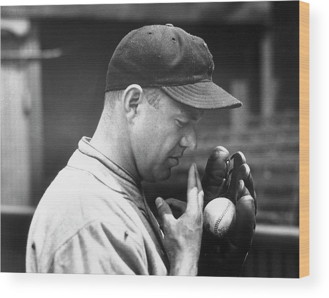 Spitting Wood Print featuring the photograph Pitcher Burleigh Grimes Demonstrating by Bettmann