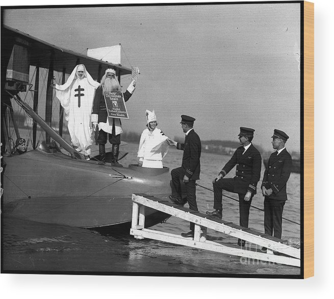People Wood Print featuring the photograph Santa Claus Arriving On Seaplane by Bettmann