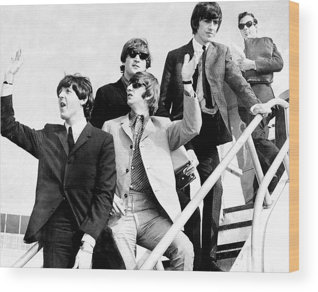 Following Wood Print featuring the photograph The Beatles, L. To R. Paul Mccartney by New York Daily News Archive