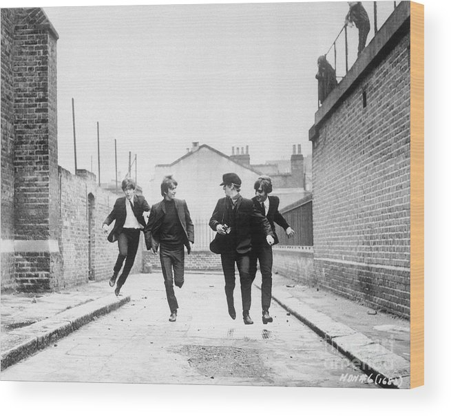 People Wood Print featuring the photograph The Beatles Running In A Hard Days Night by Bettmann