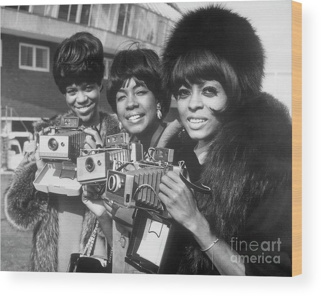 Singer Wood Print featuring the photograph The Supremes With Cameras In London by Bettmann