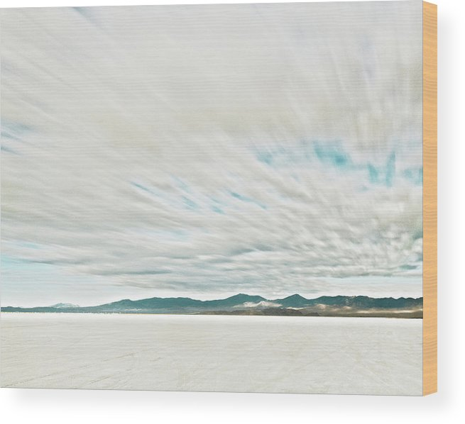 Tranquility Wood Print featuring the photograph Time Exposure Clouds In Motion Above by Andy Ryan