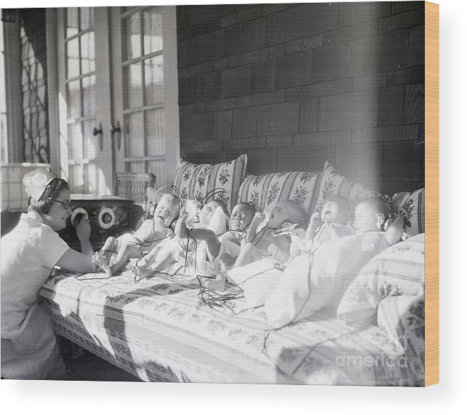 Medical Research Wood Print featuring the photograph Trying To Calm Babies With Radio by Bettmann