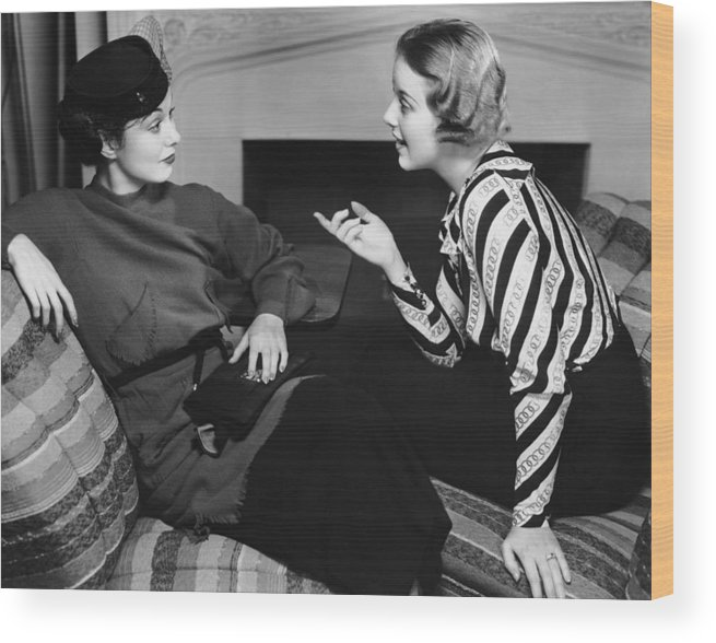 Three Quarter Length Wood Print featuring the photograph Two Women In Casual Conversation by George Marks