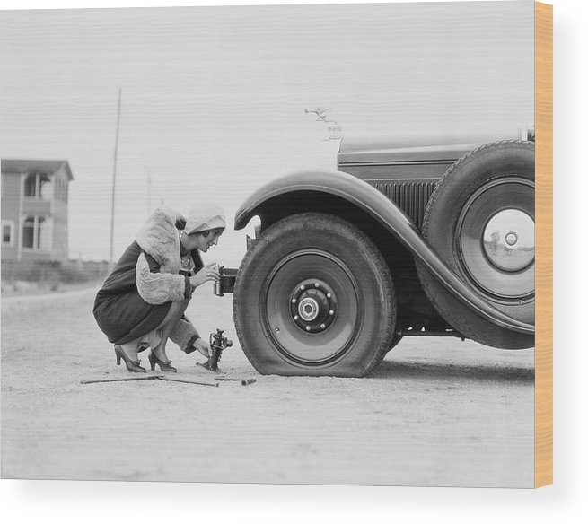 People Wood Print featuring the photograph Woman Changing Flat Tire On Car by H. Armstrong Roberts