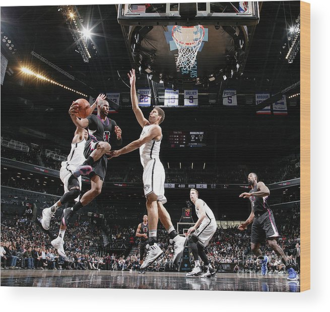 Nba Pro Basketball Wood Print featuring the photograph Brook Lopez and Chris Paul by Nathaniel S. Butler