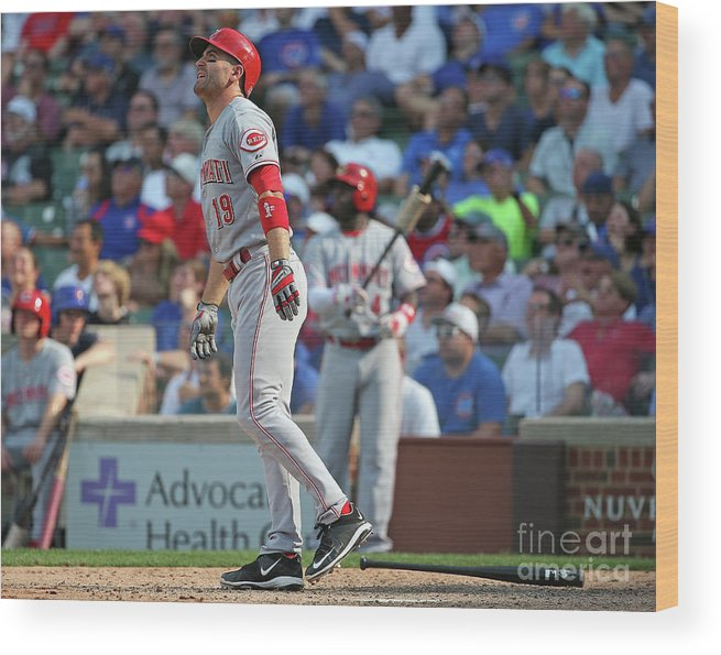 Following Wood Print featuring the photograph Joey Votto by Jonathan Daniel