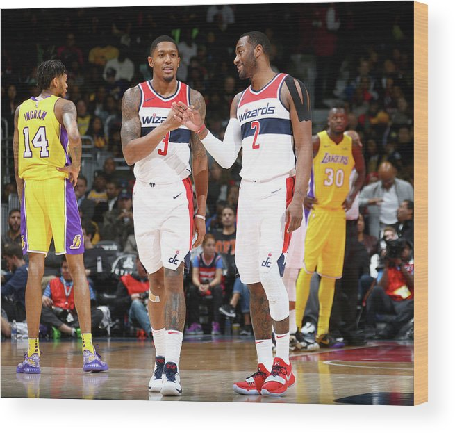 Nba Pro Basketball Wood Print featuring the photograph John Wall and Bradley Beal by Ned Dishman
