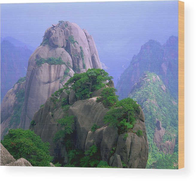 Part Of A Series Wood Print featuring the photograph A Rocky Outcropping Overlooks A Mist-covered China Mountain Range by Rubberball