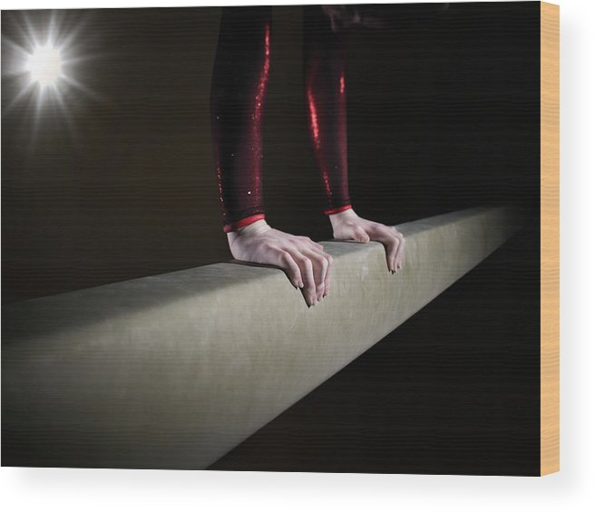 Human Arm Wood Print featuring the photograph Female Gymnast On Balancing Beam by Mike Harrington
