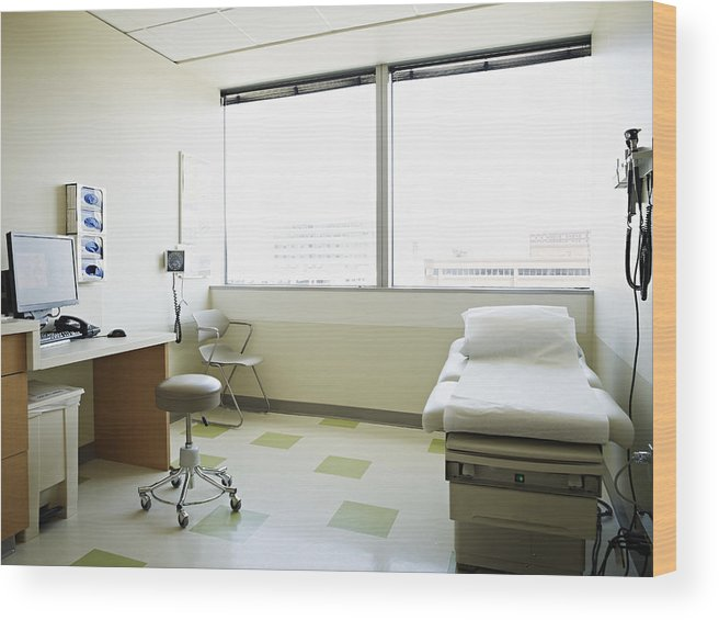 Empty Wood Print featuring the photograph Empty medical exam room by Thomas Barwick