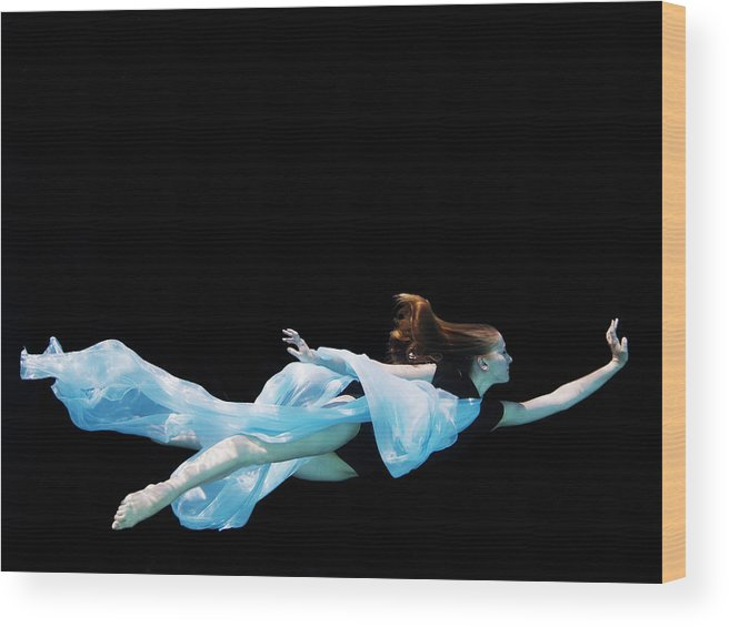 Ballet Dancer Wood Print featuring the photograph Female Dancer Underwater Against Black by Thomas Barwick