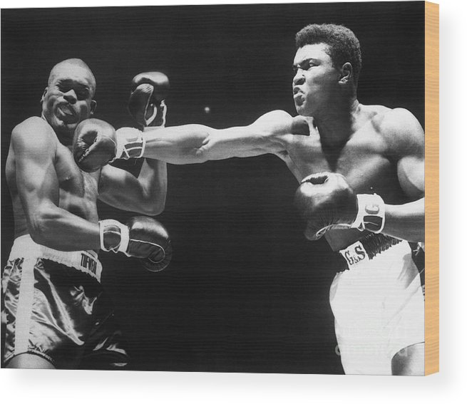 People Wood Print featuring the photograph Boxer Cassius Clay Punching Doug Jones by Bettmann