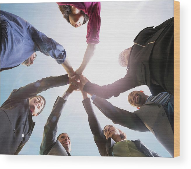 Working Wood Print featuring the photograph Business People Putting Hands Together by John M Lund Photography Inc