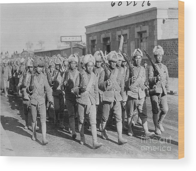 Marching Wood Print featuring the photograph Chinese Soldiers Marching With Weapons by Bettmann