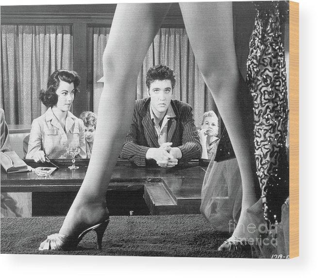 Singer Wood Print featuring the photograph Elvis Presley Framed Between Womans Legs by Bettmann