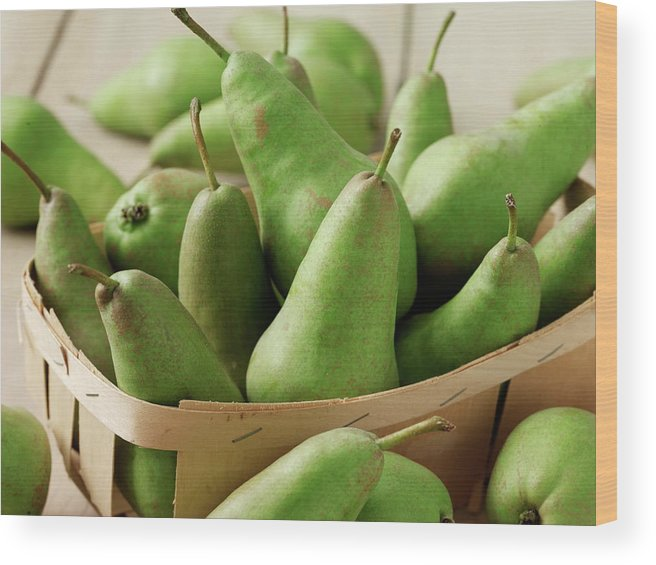 Fruit Carton Wood Print featuring the photograph Green Pears In Punnet And Wooden Table by Chris Ted
