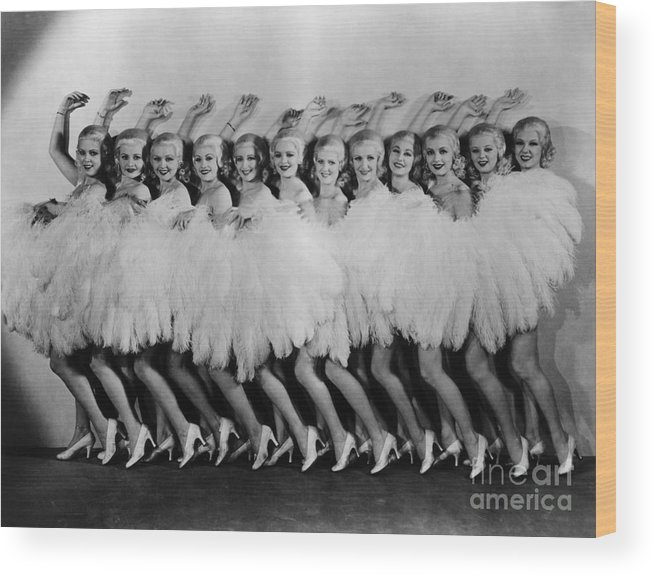 Dozen Wood Print featuring the photograph Line Of Chorus Girls In Feathered by Bettmann