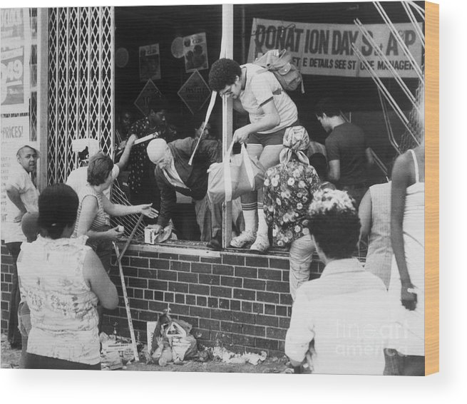 People Wood Print featuring the photograph Looters Breaking Into Store by Bettmann