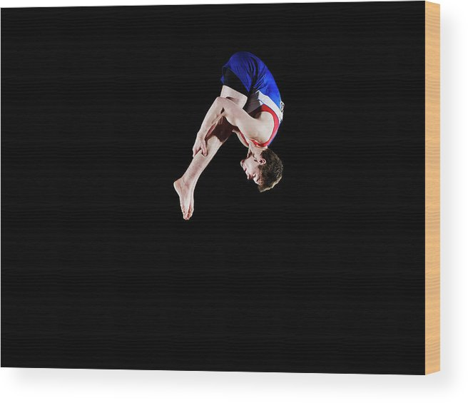 Focus Wood Print featuring the photograph Male Gymnast 16-17 Mid Air, Black by Thomas Barwick