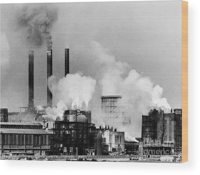 Air Pollution Wood Print featuring the photograph Smoke Rising From Factory Smokestacks by Bettmann