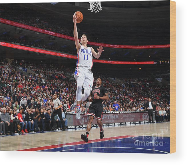 Nba Pro Basketball Wood Print featuring the photograph Nik Stauskas by Jesse D. Garrabrant