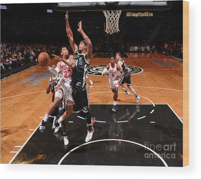 Nba Pro Basketball Wood Print featuring the photograph Cameron Payne and Drazen Petrovic by Jesse D. Garrabrant
