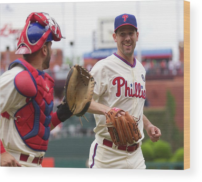 Baseball Catcher Wood Print featuring the photograph Cliff Lee And Wil Nieves by Mitchell Leff