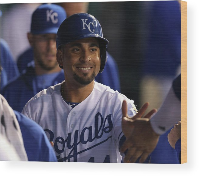 American League Baseball Wood Print featuring the photograph Eric Hosmer and Omar Infante by Ed Zurga
