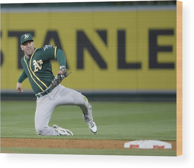 Second Inning Wood Print featuring the photograph Nick Punto and Chris Iannetta by Harry How