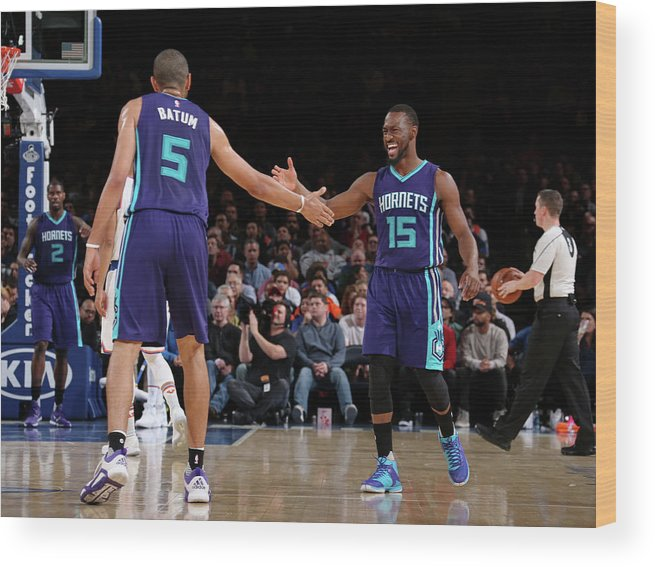 Nicolas Batum Wood Print featuring the photograph Nicolas Batum and Kemba Walker by Nathaniel S. Butler