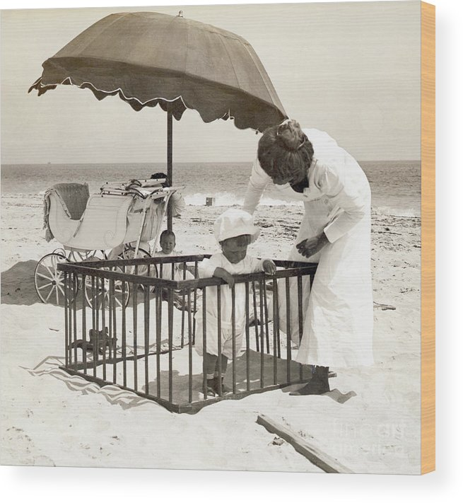 Toddler Wood Print featuring the photograph Mother With Toddler In Playpen On Beach by Bettmann