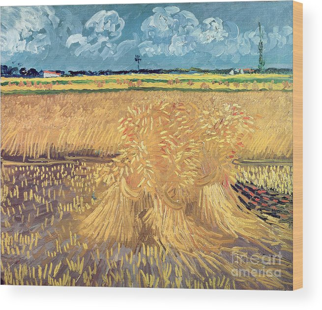 Wheatfield Wood Print featuring the painting Wheatfield with Sheaves by Vincent van Gogh