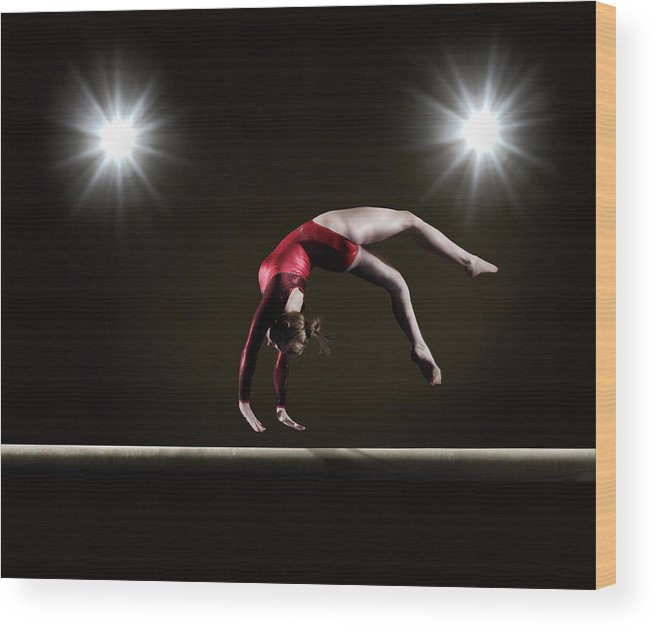 Expertise Wood Print featuring the photograph Female Gymnast On Balance Beam by Mike Harrington