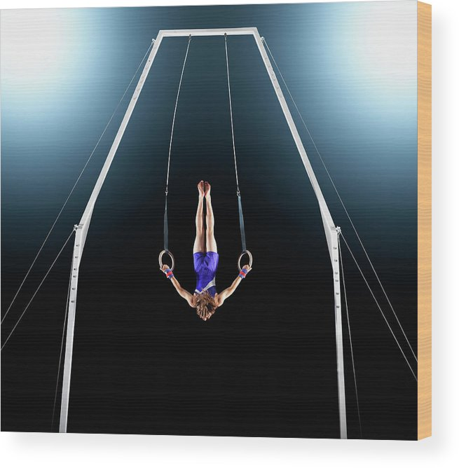 Focus Wood Print featuring the photograph Male Gymnast Upside Down Performing On by Robert Decelis Ltd