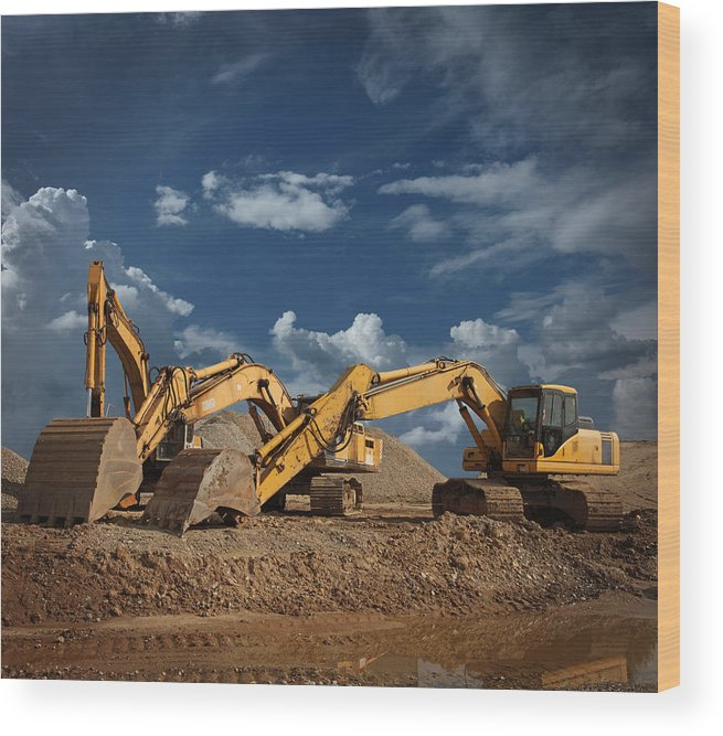 Working Wood Print featuring the photograph Three Excavators At Construction Site by Narvikk