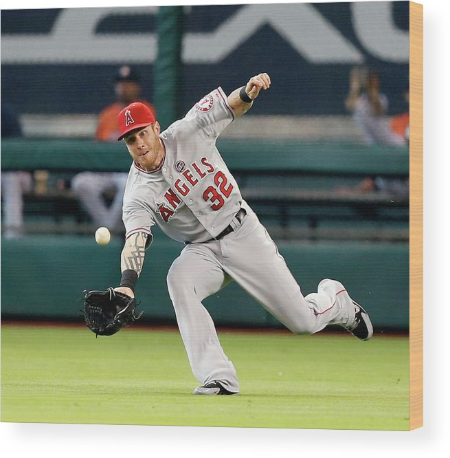 American League Baseball Wood Print featuring the photograph Josh Hamilton and Jason Castro by Bob Levey