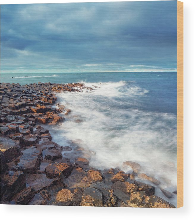 Water's Edge Wood Print featuring the photograph Giants Causeway On A Cloudy Day by Mammuth