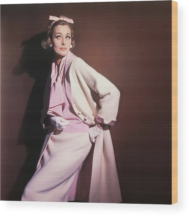 Studio Shot Wood Print featuring the photograph Model Wearing White Coat Over Pink Blouse by Horst P. Horst