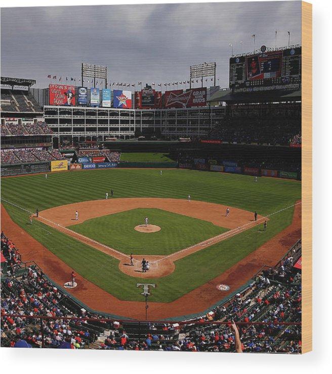 American League Baseball Wood Print featuring the photograph Houston Astros V Texas Rangers by Tom Pennington